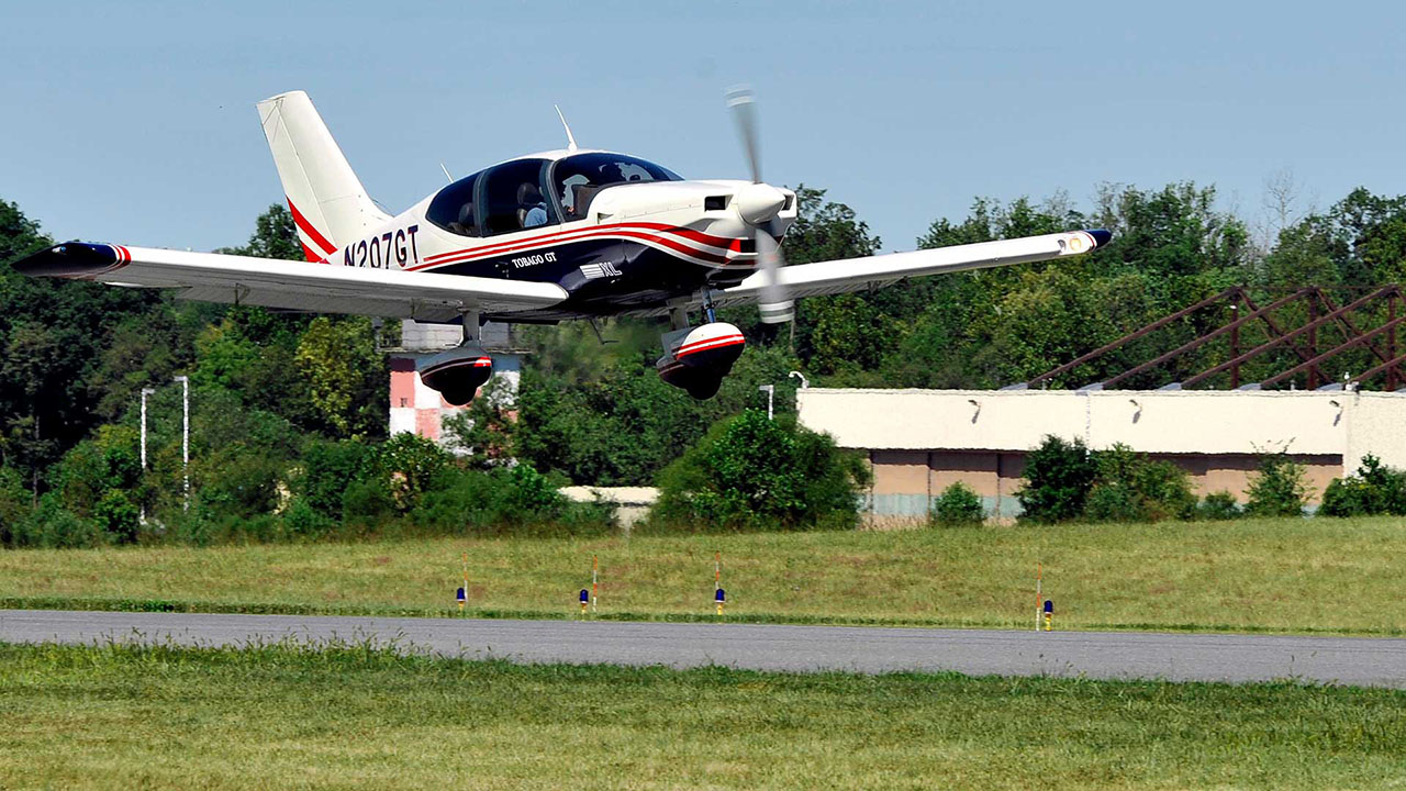 Instructor and pilot take off in Sacota at Tipton Airport
